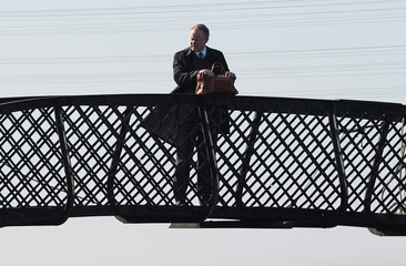"Actor Stellan Skarsgard stands on a bridge during the filming of ""The Railway Man"" at The Bo'ness and Kinneil Steam Railway in Bo'ness"