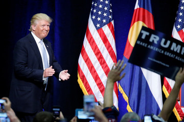 Republican presidential nominee Donald Trump walks on stage at a campaign rally in Colorado Springs