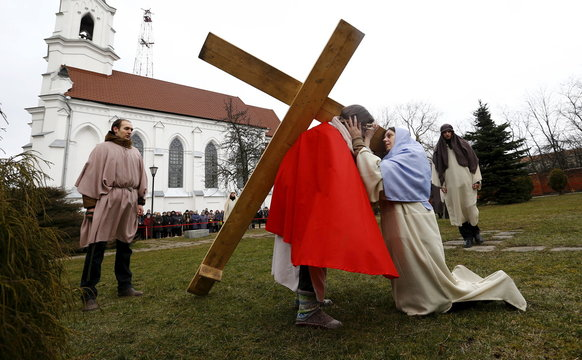 Belarussian Catholics re-enact a moment in the life of Jesus Christ near a Catholic church in Minsk