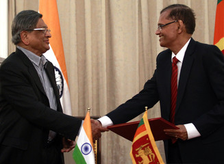 India's Foreign Minister Krishna shakes hands with his Sri Lankan counterpart Peiris during their meeting in Colombo