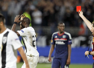 Maazou of Vitoria Guimaraes is shown a red card by referee Florian Meyer during their Europa League soccer match against Olympique Lyon at the Gerland stadium in Lyon