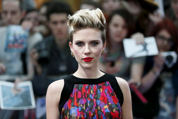 """Cast member Johansson poses at the european premiere of """"Avengers: Age of Ultron"""" at Westfield shopping centre, Shepherds Bush, London"""