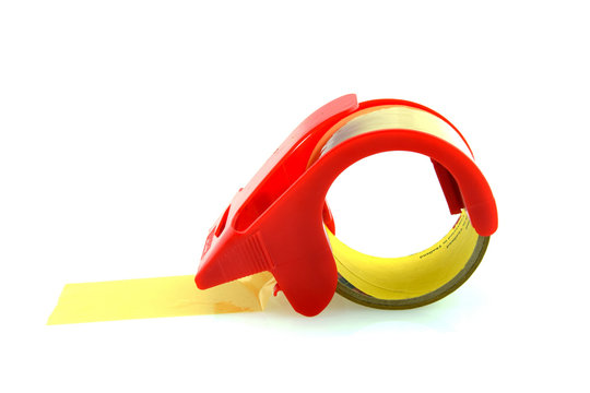 Red adhesive tape roll dispenser isolated on white background.