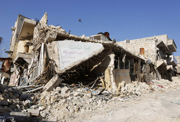 A damaged building is pictured in Masaken Hanano in Aleppo