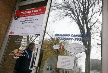 A voter arrives at a bowling alley being used as a polling station in the U.S. midterm elections in Chicago