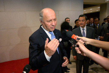 French Foreign Minister Laurent Fabius talks to the media at China's National Museum in Beijing