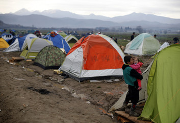 Migrant children are pictured outside a tent at a makeshift camp on the Greek-Macedonian border, near the village of Idomeni