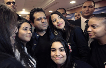 Presidential candidate Slim Riahi poses for a photo with young people in Tunis