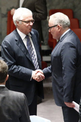 Netherlands' Foreign Minister Timmermans shakes hands with Russia's Ambassador to the U.N. Vitaly Churkin before a Security Council meeting at the U.N. headquarters in New York