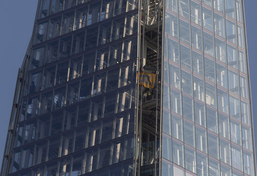 "Greenpeace demonstrators unveil a banner reading ""Save the Arctic"" after climbing the Shard building, in central London"