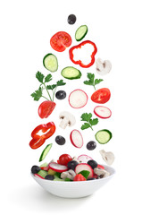 flying salad in plate isolated on white
