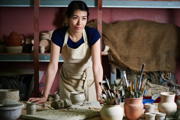 Charming pottery artist working in studio