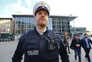 Federal police officer wearing 'body-cam' poses for a picture in Cologne