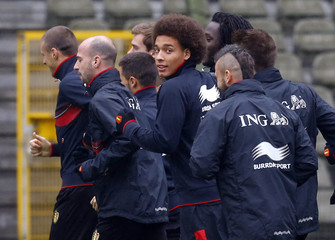 Belgium's national soccer team player Witsel runs with teammates during a training session at the King Baudouin stadium in Brussels