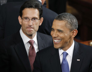 U.S. Rep. Cantor is pictured behind President Obama inside the chamber of the House of Representatives on Capitol Hill in Washington