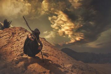 Wayfarer in the sand desert