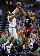 Boston Celtics' Pierce drives to the net on Miami Heat's Battier during the third quarter in Game 3 of their Eastern Conference Finals NBA basketball playoffs in Boston