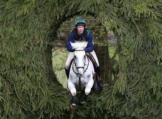 Ireland's Mark Klye on Step In Time navigates the Owl Hole jump during the cross country on the third day of The Badminton Horse Trials in Badminton