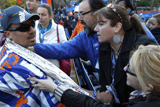Chilean miner Edison Pena greeted by friends after finishing New York City Marathon