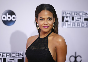 Actress Christina Milian arrives at the 42nd American Music Awards in Los Angeles