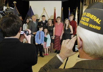 Attendees take pictures with Senator Mitch McConnell before the presentation of a Purple Heart at the VFW Post 1170 in Louisville