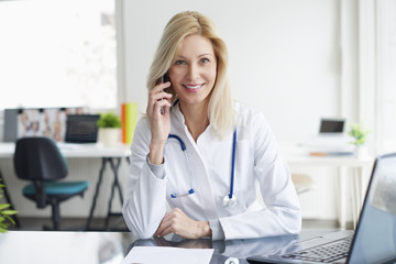 Female doctor giving advise on telephone