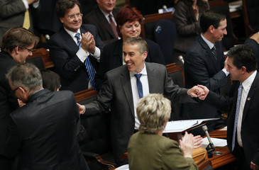 Quebec's Minister of Finance Marceau shakes hands with colleagues after presenting his provincial budget at the National Assembly in Quebec City