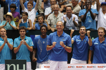 French team captain Guy Forget celebrates the victory of Michael Llodra of France against Fernando Verdasco of Spain during their singles Davis Cup World group quarter-final tennis match in Clermont-Ferrand