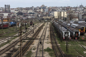 A woman crosses railway tracks on the site where the Belgrade Waterfront project will be built in Belgrade