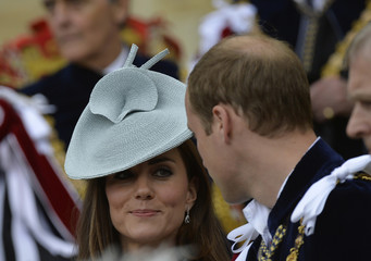 Britain's Catherine speaks with her husband Prince William after attending the Order of the Garter procession and installation service at Windsor Castle in southern England