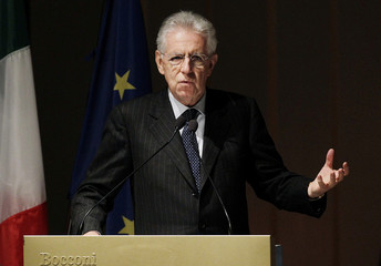 Italian PM Monti gestures as he speaks during the opening ceremony of the academic year at the Bocconi University in Milan
