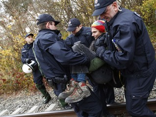 German riot police remove an anti-nuclear protestor from a railway track during a demonstration against the transport of Castor nuclear waste containers in Berg near the German French border in south-west Germany