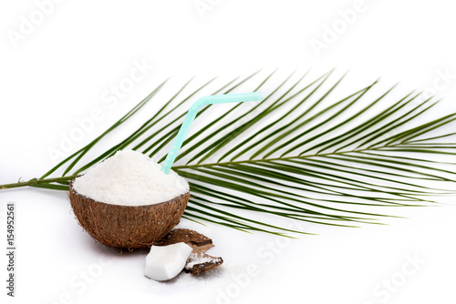 Close-up view of half of tasty coconut with shavings and