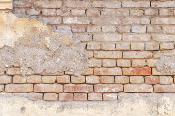 Big wall of old cracked brick background