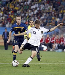 Germany's Thomas Mueller kicks to score a goal against Australia during a 2010 World Cup Group D soccer match at Moses Mabhida stadium in Durban