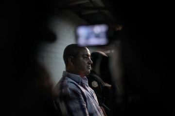 Suspect Elio Lorenzana speaks to the media at the Supreme Court in Guatemala City