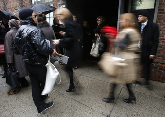 Attendees leave the Donna Karan Autumn/Winter 2013 collection during New York Fashion Week