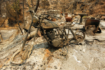 A motorcycle sits at the site of a destroyed home after the Soberanes Fire burned through the Palo Colorado area, north of Big Sur, California