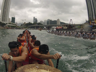 Participants compete in a dragon boat race to mark the annual Tuen Ng or Dragon Boat Festival at Hong Kong's Aberdeen Harbour