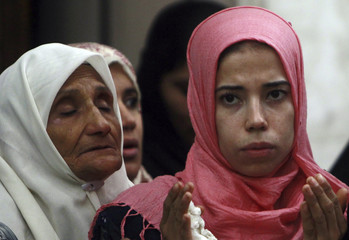 Muslim women pray at Hussein mosque in the old city of Cairo