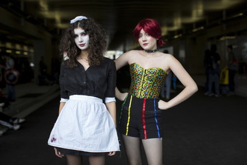 Olivia Alicandri dressed as Magenta and Olivia Viteznik dressed as Columbia, both characters from Rocky Horror Picture Show, pose for photos on day two of New York Comic Con in Manhattan, New York