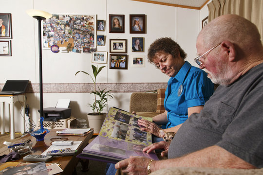 Paula and Raymond Wheeler look through a scrapbook of the memorial service for their daughter in their home in Crossville