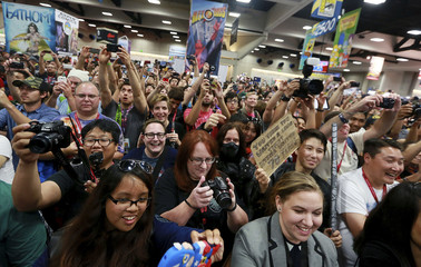 "The crowd cheers during an autograph signing session with cast and production team for ""Marvel's Agent of S.H.I.E.L.D."" during the 2014 Comic-Con International Convention in San Diego, California"