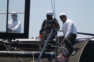Rapper MC Hammer and Team Oracle Racing skipper Russell Coutts make sail during a guest race aboard an Oracle AC45 sailboat on San Francisco Bay