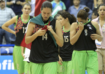 Mexico team members walk off the court after they lost to Puerto Rico in the women's final basketball game at the Pan American Games in Guadalajara