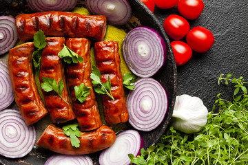 Grilled sausage, herbs and vegetables