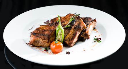 Grilled beef meat on a white plate