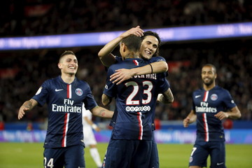 Paris St Germain's Gregory Van Der Wiel celebrates with Edinson Cavani after scoring during their French Ligue 1 soccer match against Metz at Parc des Princes stadium in Paris