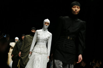 Models present creations by Norma Hauri during the Autumn/Winter 2016 Tokyo Fashion Week in Tokyo