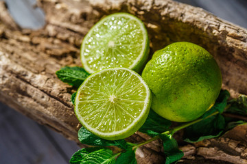 Lime and mint on a beautiful wooden background